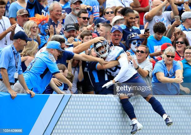 Dane Cruikshank of the Tennessee Titans jumps into the crowd after scoring a touchdown against the Houston Texans at Nissan Stadium on September 16...