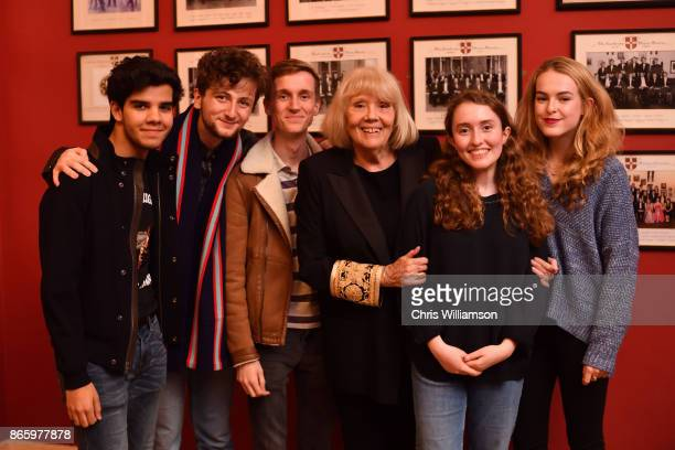 Dane Diana Rigg poses with students at The Cambridge Union on October 24 2017 in Cambridge Cambridgeshire