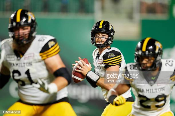 Dane Evans of the Hamilton TigerCats looks to pass in the game between the Hamiton TigerCats and Saskatchewan Roughriders at Mosaic Stadium on August...