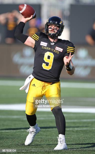 Dane Evans of the Hamilton Tiger-Cats warms up prior to action against the Winnipeg Blue Bombers in a CFL game at Tim Hortons Field on June 29, 2018...