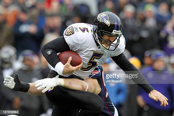 Dane Fletcher of the New England Patriots tackles Joe Flacco of the Baltimore Ravens in the first quater during their AFC Championship Game at...