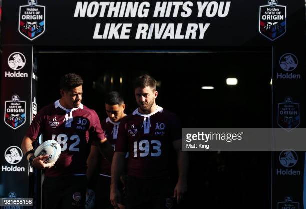 Dane Gagai and Ben Hunt walk onto the field during the Queensland Maroons State of Origin captain's run at ANZ Stadium on June 23 2018 in Sydney...
