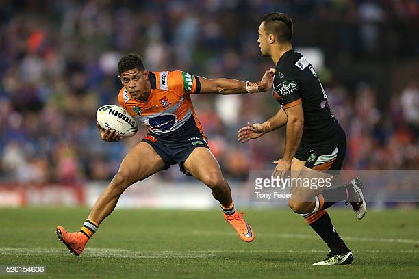 Dane Gagai of the Knights avoids a tackle by Luke Brooks of the Tigers during the round six NRL match between the Newcastle Knights and the Wests...