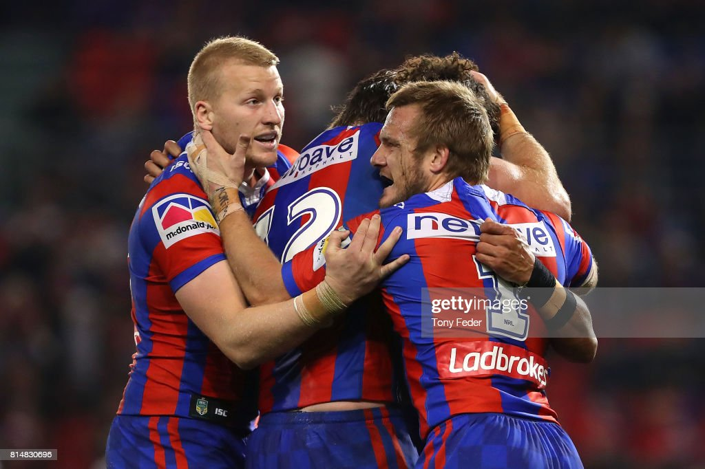 Dane Gagai of the Knights celebrates a try with team mates during the round 19 NRL match between the Newcastle Knights and the Brisbane Broncos at McDonald Jones Stadium on July 15, 2017 in Newcastle, Australia.