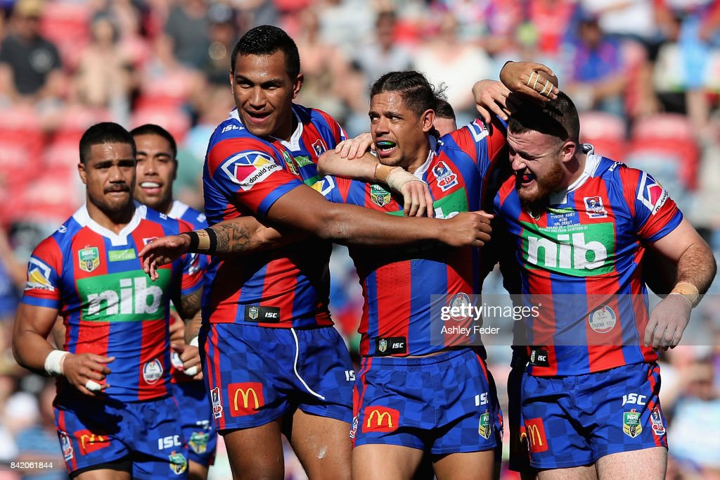 Dane Gagai of the Knights celebrates the first try from the Knights with team mates during the round 26 NRL match between the Newcastle Knights and the Cronulla Sharks at McDonald Jones Stadium on September 3, 2017 in Newcastle, Australia.