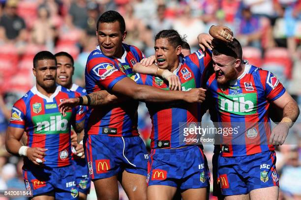 Dane Gagai of the Knights celebrates the first try from the Knights with team mates during the round 26 NRL match between the Newcastle Knights and...