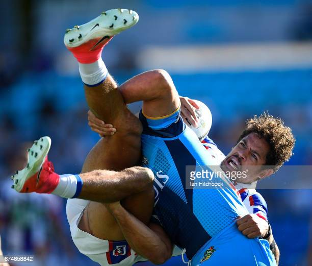 Dane Gagai of the Knights is tackled by Jarryd Hayne of the Titans during the round nine NRL match between the Gold Coast Titans and the Newcastle...