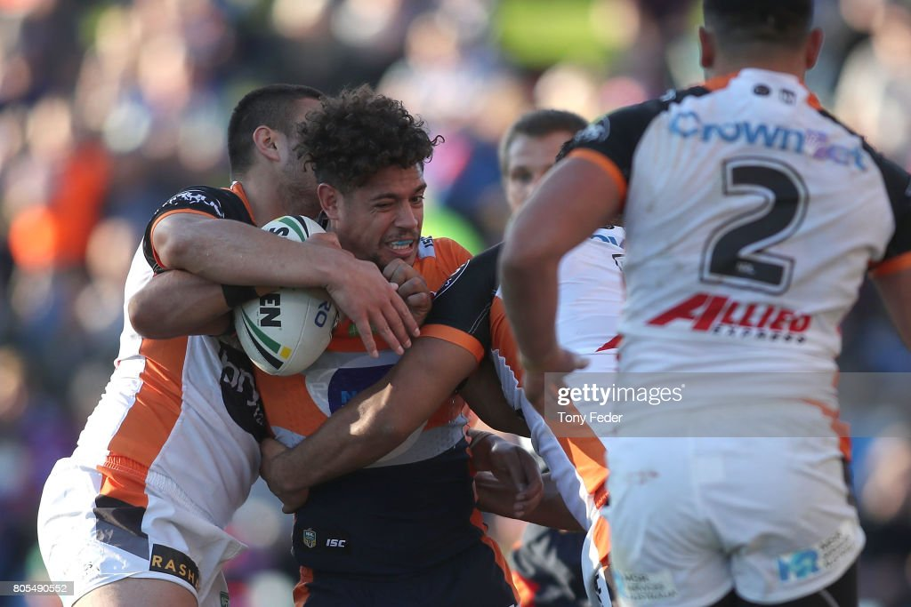 Dane Gagai of the Knights is tackled by the Tigers defence during the round 17 NRL match between the Newcastle Knights and the Wests TIgers at McDonald Jones Stadium on July 2, 2017 in Newcastle, Australia.