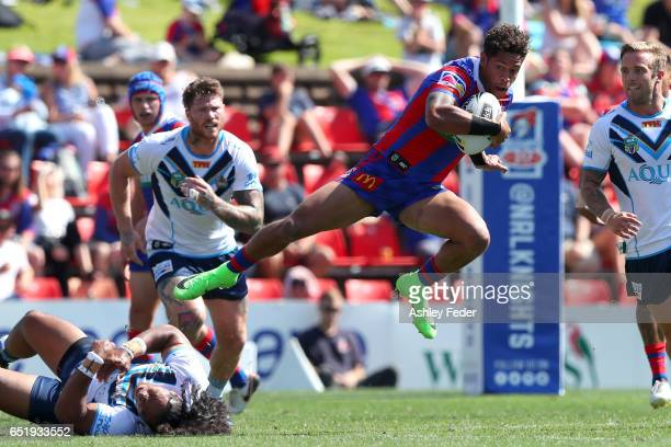 Dane Gagai of the Knights is tackled by the Titans defence during the round two NRL match between the Newcastle Knights and the Gold Coast Titans at...