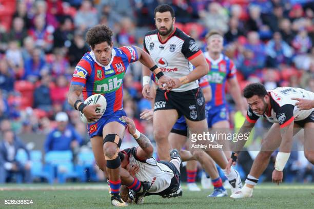 Dane Gagai of the Knights is tackled by the Warriors defence during the round 22 NRL match between the Newcastle Knights and the New Zealand Warriors...