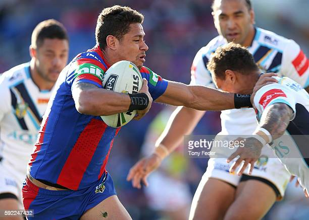 Dane Gagai of the Knights is tackled during the round 24 NRL match between the Newcastle Knights and the Gold Coast Titans at Hunter Stadium on...