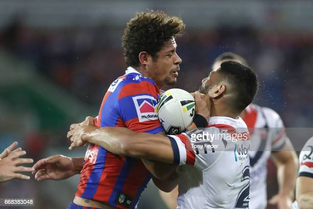 Dane Gagai of the Knights is tackled during the round seven NRL match between the Newcastle Knights and the Sydney Roosters at McDonald Jones Stadium...