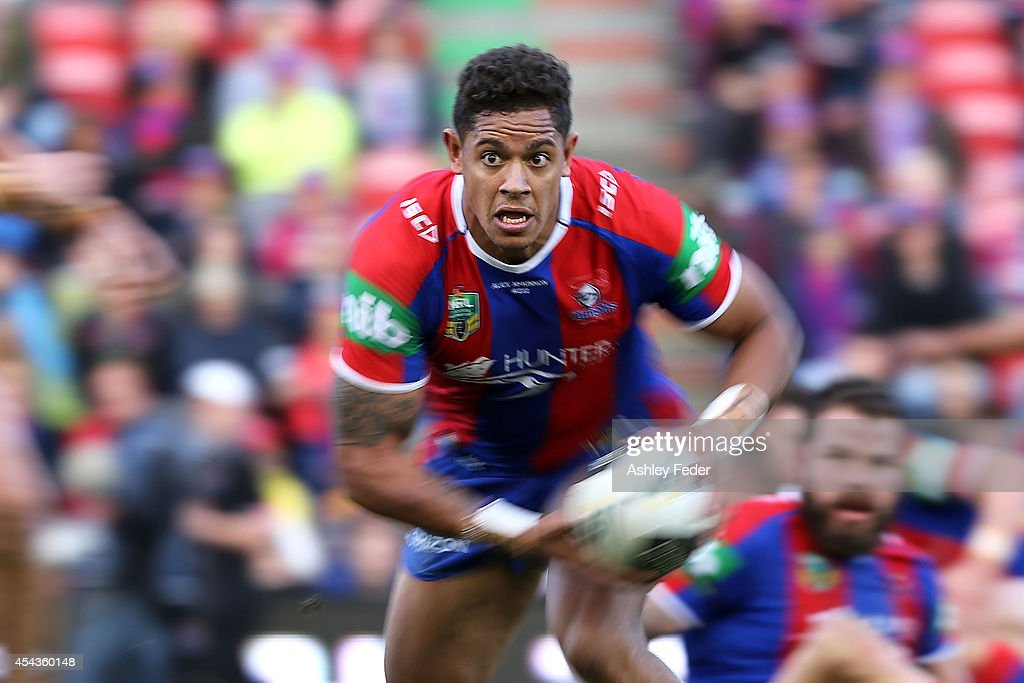 Dane Gagai of the Knights runs the ball during the round 25 NRL match between the Newcastle Knights and the Parramatta Eels at Hunter Stadium on August 30, 2014 in Newcastle, Australia.