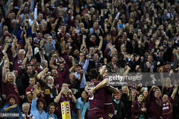 Dane Gagai of the Maroons celebrates scoring a try with Cooper Cronk during game two of the State Of Origin series between the Queensland Maroons and...