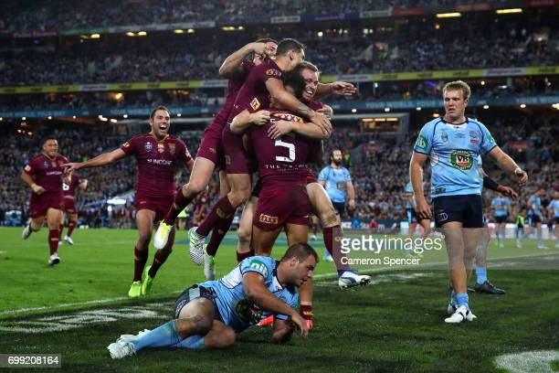 Dane Gagai of the Maroons celebrates with team mates after scoring a try during game two of the State Of Origin series between the New South Wales...