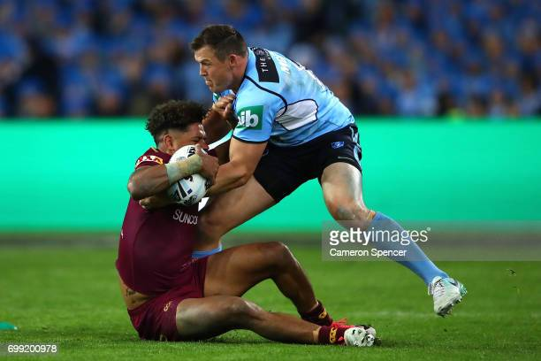 Dane Gagai of the Maroons is tackled by during game two of the State Of Origin series between the New South Wales Blues and the Queensland Maroons at...