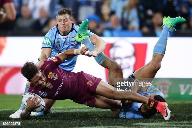 Dane Gagai of the Maroons is tackled in goal by Brett Morris and Jarryd Hayne of the Blues during game two of the State Of Origin series between the...