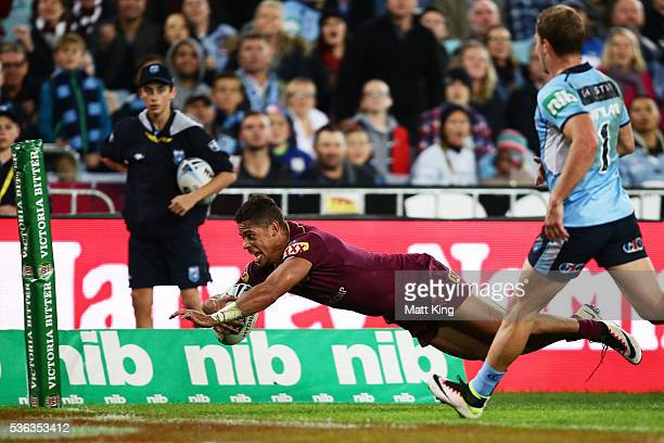 Dane Gagai of the Maroons scores a try in the corner during game one of the State Of Origin series between the New South Wales Blues and the...