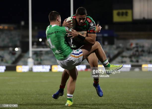 Dane Gagai of the Rabbitohs gets past a tackle from Charnze Nicoll-Klokstad of the Raiders to score during the round 11 NRL match between the...