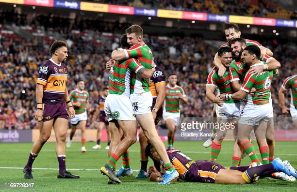 Dane Gagai of the Rabbitohs is congratulated by team mates after scoring a try during the round 23 NRL match between the Brisbane Broncos and the...