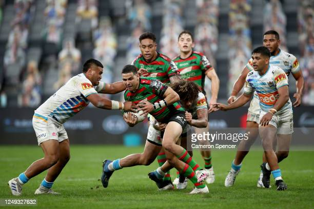 Dane Gagai of the Rabbitohs is tackled by Kevin Proctor of the Titans during the round five NRL match between the South Sydney Rabbitohs and the Gold...