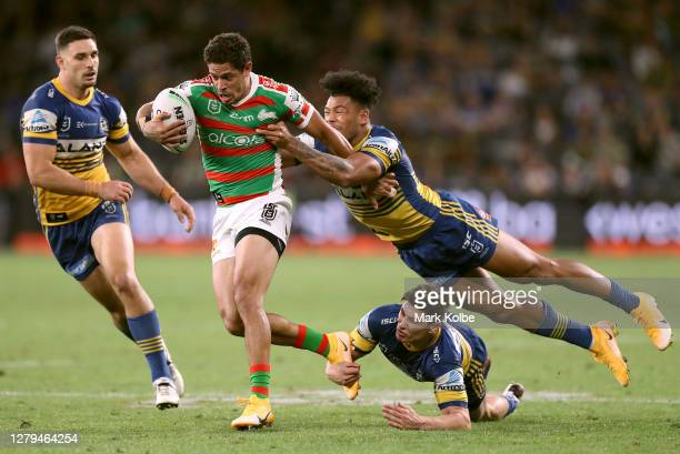 Dane Gagai of the Rabbitohs is tackled by Waqa Blake of the Eels during the NRL Semi Final match between the Parramatta Eels and the South Sydney...