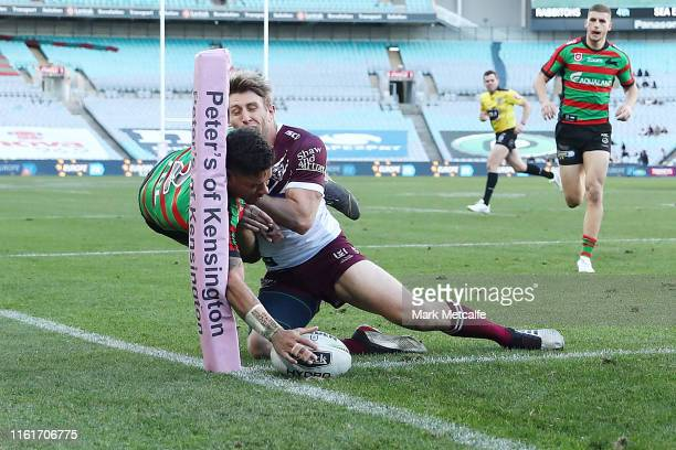 Dane Gagai of the Rabbitohs scores a try during the round 17 NRL match between the South Sydney Rabbitohs and the Manly Sea Eagles at ANZ Stadium on...