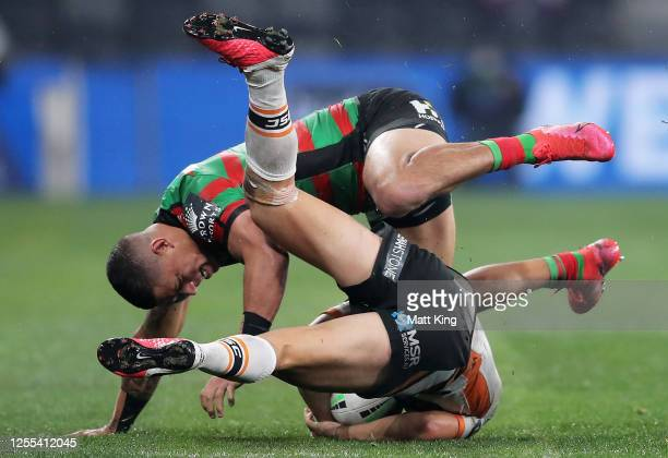 Dane Gagai of the Rabbitohs tackles Luke Brooksof the Tigers during the round nine NRL match between the South Sydney Rabbitohs and the Wests Tigers...