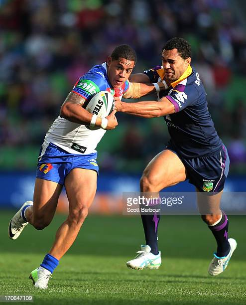 Dane Gagaii of the Knights is tackled by Justin O'Neill of the Storm during the round 14 NRL match between the Melbourne Storm and the Newcastle...