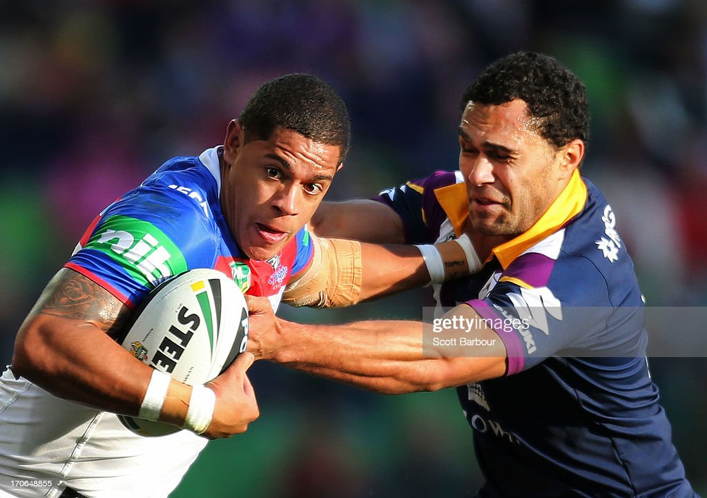Dane Gagaii of the Knights is tackled by Justin O'Neill of the Storm during the round 14 NRL match between the Melbourne Storm and the Newcastle Knights at AAMI Park on June 16, 2013 in Melbourne, Australia.