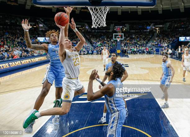 Dane Goodwin of the Notre Dame Fighting Irish shoots the ball against Leaky Black of the North Carolina Tar Heels during the first half at Purcell...
