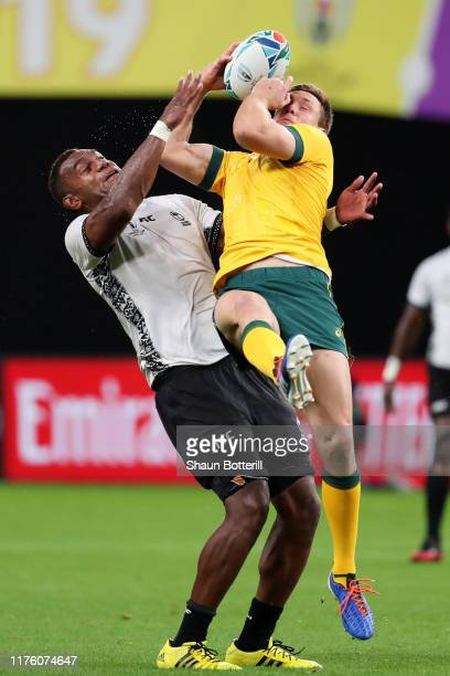 Dane HaylettPetty of Australia and Leone Nakarawa of Fiji compete for the ball during the Rugby World Cup 2019 Group D game between Australia and...