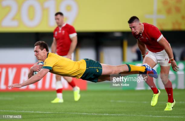 Dane Haylett-Petty of Australia goes over to score his team's second try during the Rugby World Cup 2019 Group D game between Australia and Wales at...