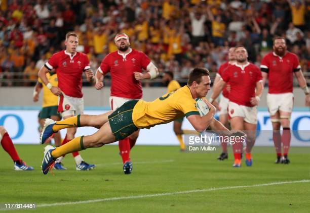 Dane HaylettPetty of Australia goes over to score his team's second try during the Rugby World Cup 2019 Group D game between Australia and Wales at...