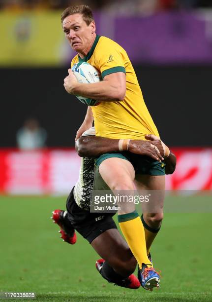 Dane Haylett-Petty of Australia is tackled by Vereniki Goneva of Fiji during the Rugby World Cup 2019 Group D game between Australia and Fiji at...