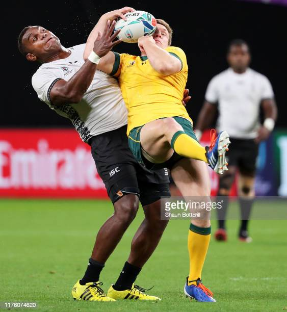 Dane HaylettPetty of Australia is tackled Leone Nakarawa of Fiji during the Rugby World Cup 2019 Group D game between Australia and Fiji at Sapporo...