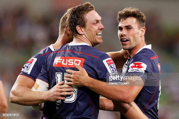 Dane HaylettPetty of the Rebels celebrates a try with Tom English of the Rebels during the round two Super Rugby match between the Melbourne Rebels...
