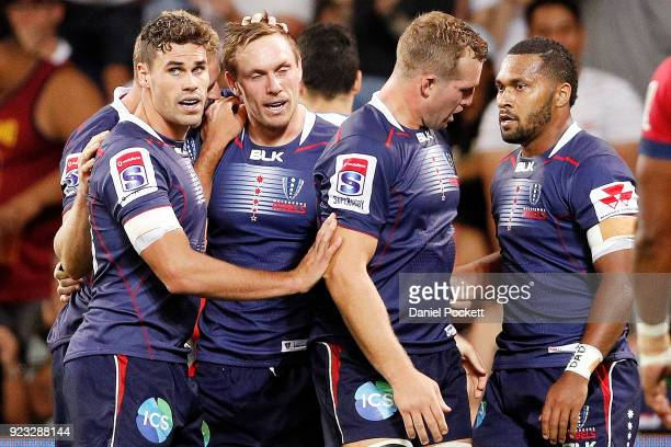 Dane HaylettPetty of the Rebels celebreates a goal with teammates during the round two Super Rugby match between the Melbourne Rebels and the...
