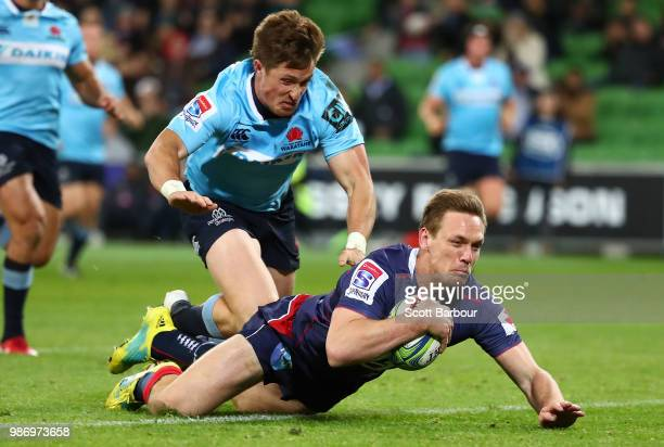 Dane HaylettPetty of the Rebels dives to score a try during the round 17 Super Rugby match between the Rebels and the Waratahs at AAMI Park on June...
