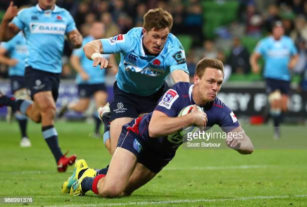 Dane Haylett-Petty of the Rebels dives to score a try during the round 17 Super Rugby match between the Rebels and the Waratahs at AAMI Park on June...