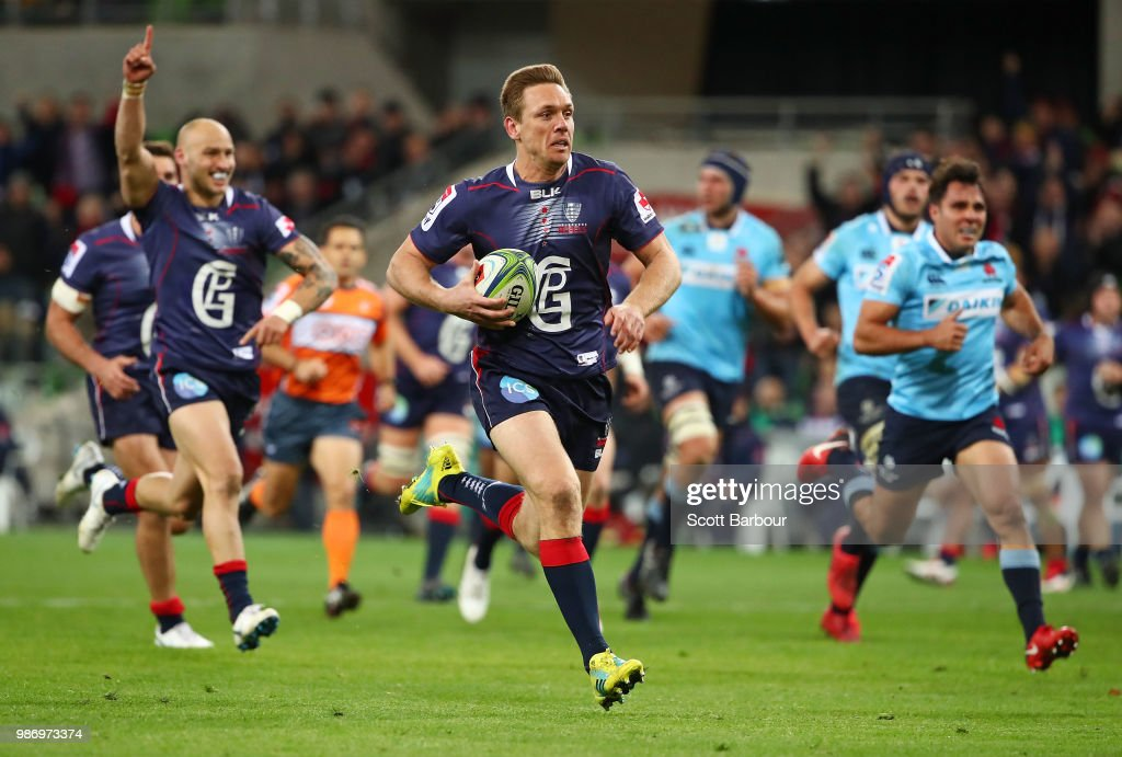 Dane Haylett-Petty of the Rebels runs in to score a try during the round 17 Super Rugby match between the Rebels and the Waratahs at AAMI Park on June 29, 2018 in Melbourne, Australia.