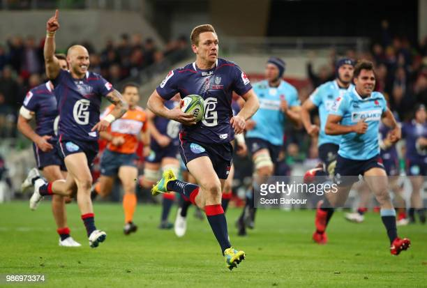 Dane HaylettPetty of the Rebels runs in to score a try during the round 17 Super Rugby match between the Rebels and the Waratahs at AAMI Park on June...