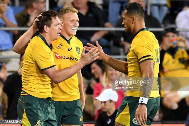 Dane HaylettPetty of the Wallabies celebrates with team mates after scoring a try during The Rugby Championship match between the Australian...