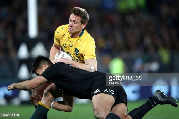 Dane HaylettPetty of the Wallabies is tackled by Rieko Ioane of the All Blacks during The Rugby Championship Bledisloe Cup match between the New...