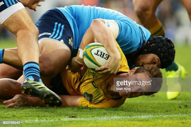 Dane HaylettPetty of the Wallabies is tackled just short of the line during the International Test match between the Australian Wallabies and Italy...