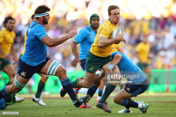 Dane HaylettPetty of the Wallabies runs the ball during the International Test match between the Australian Wallabies and Italy at Suncorp Stadium on...