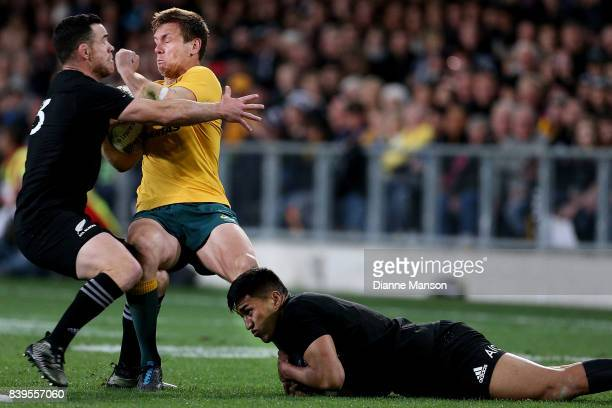 Dane HaylettPetty of the Wallabies tries to break the tackle of Ryan Crotty and Rieko Ioane of the All Blacks during The Rugby Championship Bledisloe...