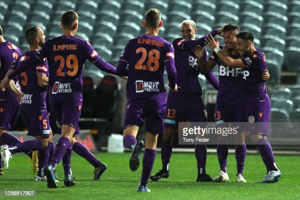 Dane Ingham of Perth Glory celebrates a goal with team mates during the round 29 ALeague match between the Perth Glory and the Central Coast Mariners...