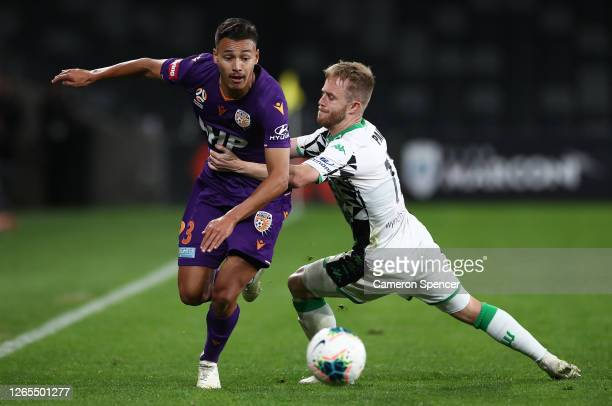 Dane Ingham of the Glory is challenged Connor Pain of Western United during the round 24 A-League match between the Perth Glory and Western United at...