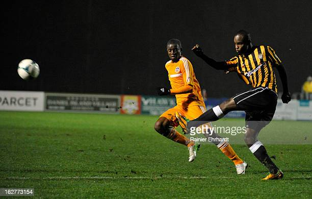 Dane Kelly of the Charleston Battery makes a pass as Boniek Garcia of the Houston Dynamo defends during the first half of the Carolina Challenge Cup...